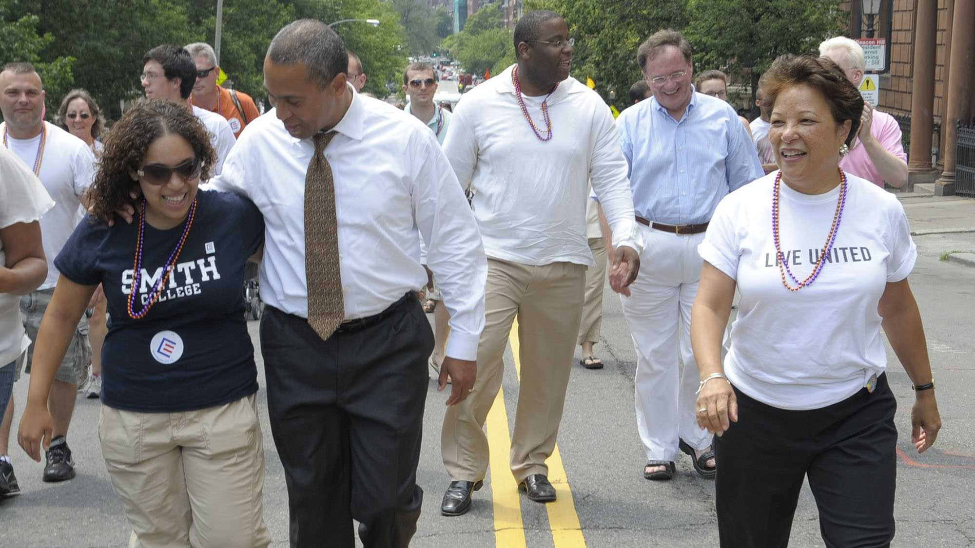 Gov. Deval Patrick, second from left, puts his arm around his daughter Katherine Patrick, left, as he walks with his family in the gay pride parade, Saturday, June 14, 2008 in Boston. Patrick's wife Diane Patrick is walking at right.