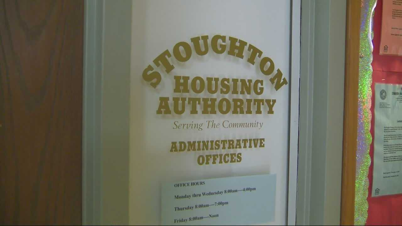 The executive director of the Stoughton Housing Authority was arrested Friday on charges including breaking and entering and theft of a controlled substance.