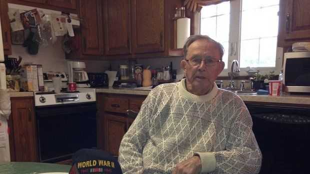 Bart Hastings, 89, of West Springfield, sits in his home and recalls his experience as a POW in Germany during World War II. Dec. 4, 2014.