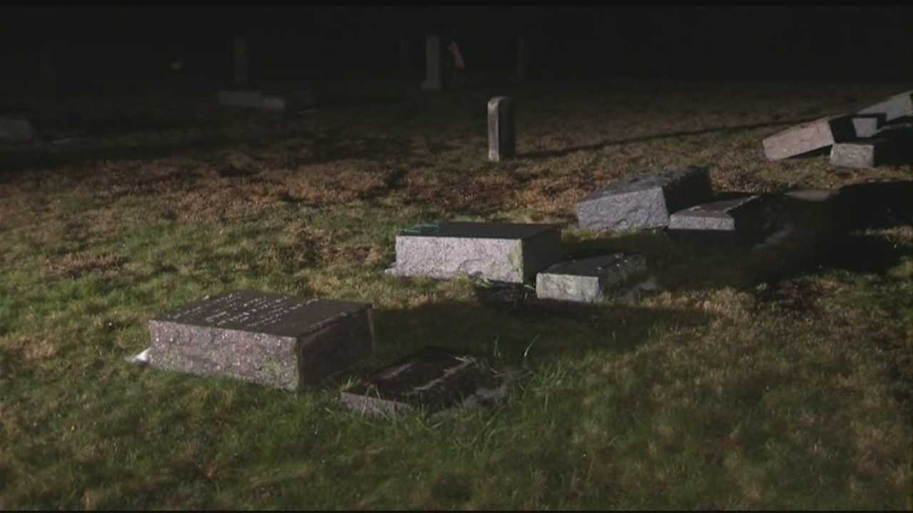 More than 60 gravestones in a Whitman cemetery, including that of a decorated member of the U.S. armed forces, were knocked over Sunday in an apparent act of vandalism.