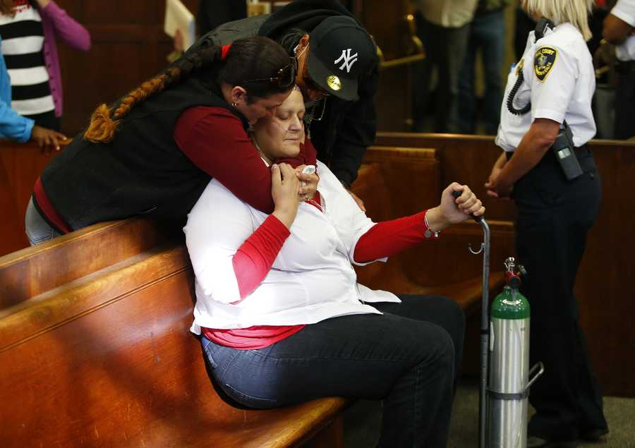 """""""Gina"""" Valderrama Mercado, left,lives with her sister, Singleton.Mercado is listed as a potential witness for the prosecution."""
