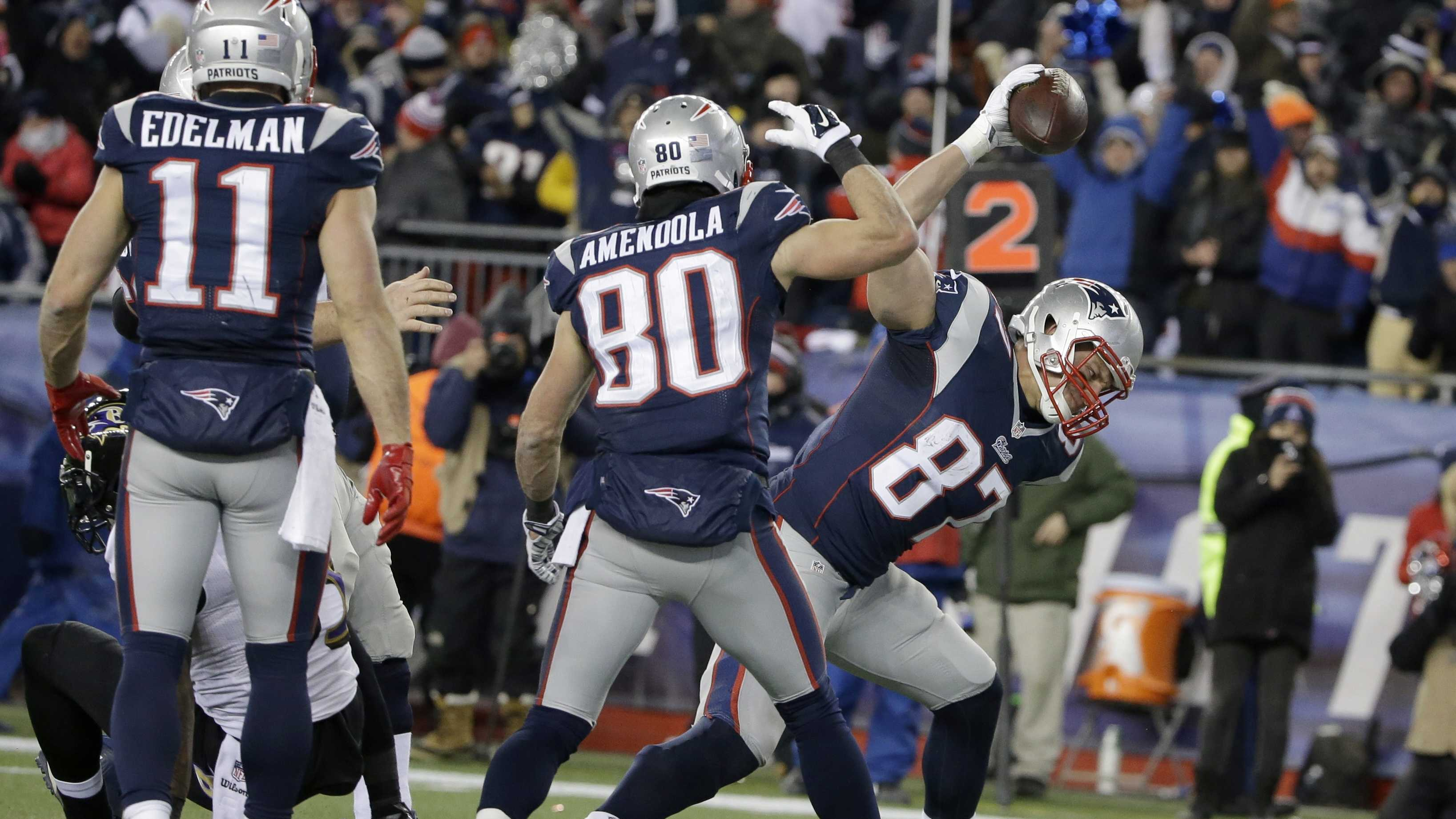 New England Patriots tight end Rob Gronkowski (87) celebrates his touchdown in the second half of an NFL divisional playoff football game against the Baltimore Ravens Saturday, Jan. 10, 2015, in Foxborough, Mass.