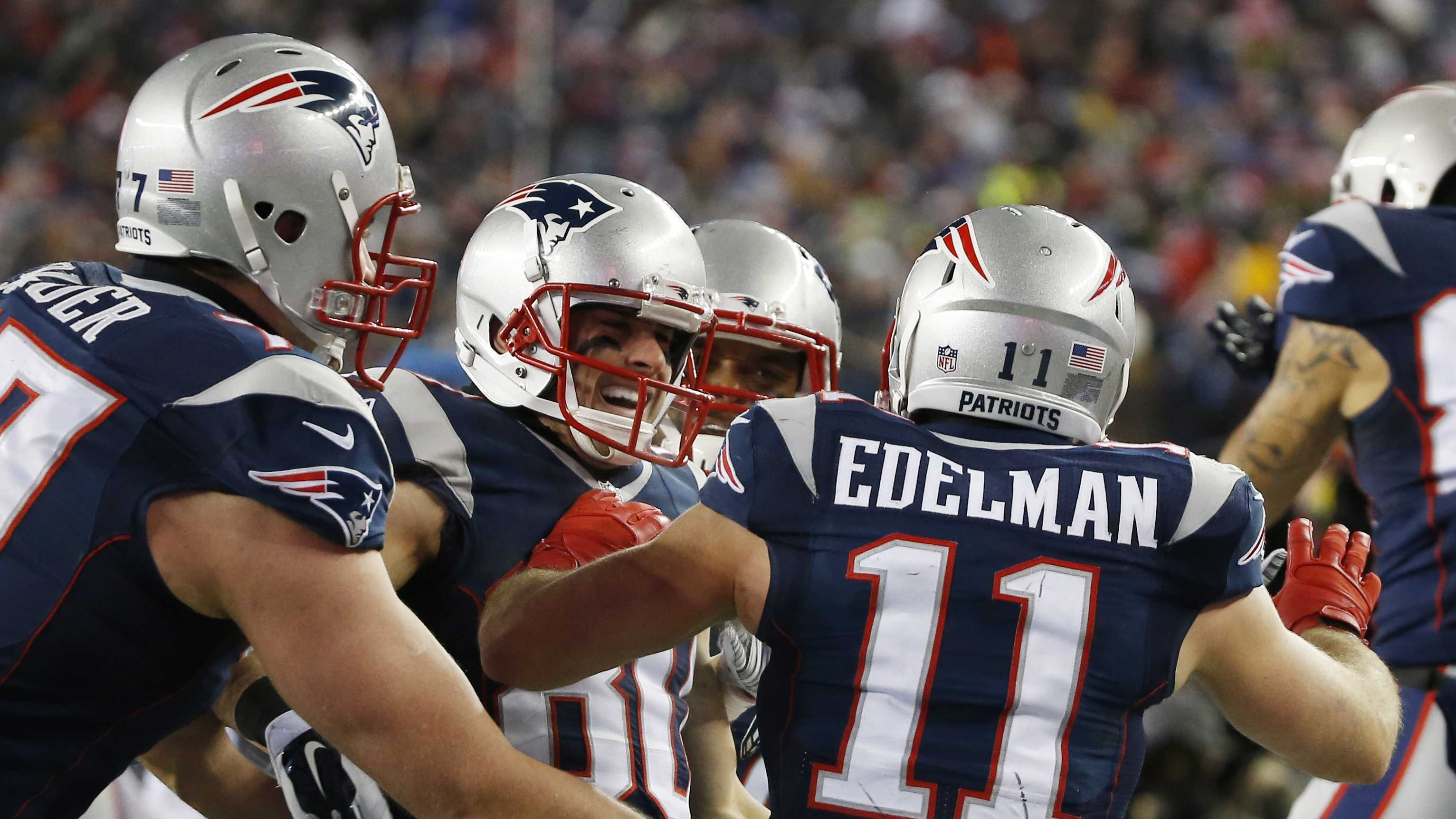New England Patriots wide receiver Danny Amendola, center, celebrates his 51-yard touchdown pass from Julian Edelman (11) in the second half of an NFL divisional playoff football game against the Baltimore Ravens Saturday, Jan. 10, 2015, in Foxborough, Mass.