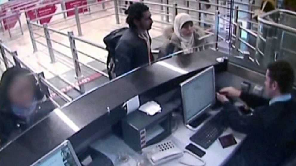 Turkish media reported that video has emerged apparently showing Hayat Boumeddiene, right, traveling through Istanbul airport, Jan. 2, 2015 next to an unidentified man, left.