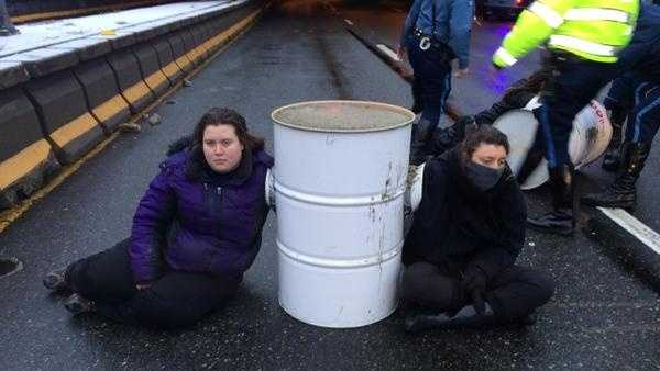 Some members of the group had their arms sealed inside the barrels.
