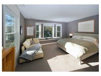 In addition to a Master suite with walk-in closet, sitting room, and bath, the extraordinary recreation/family room with its huge spa bathroom, separate entrance, and lovely outdoor views could function as a guest room, au pair suite or gym.
