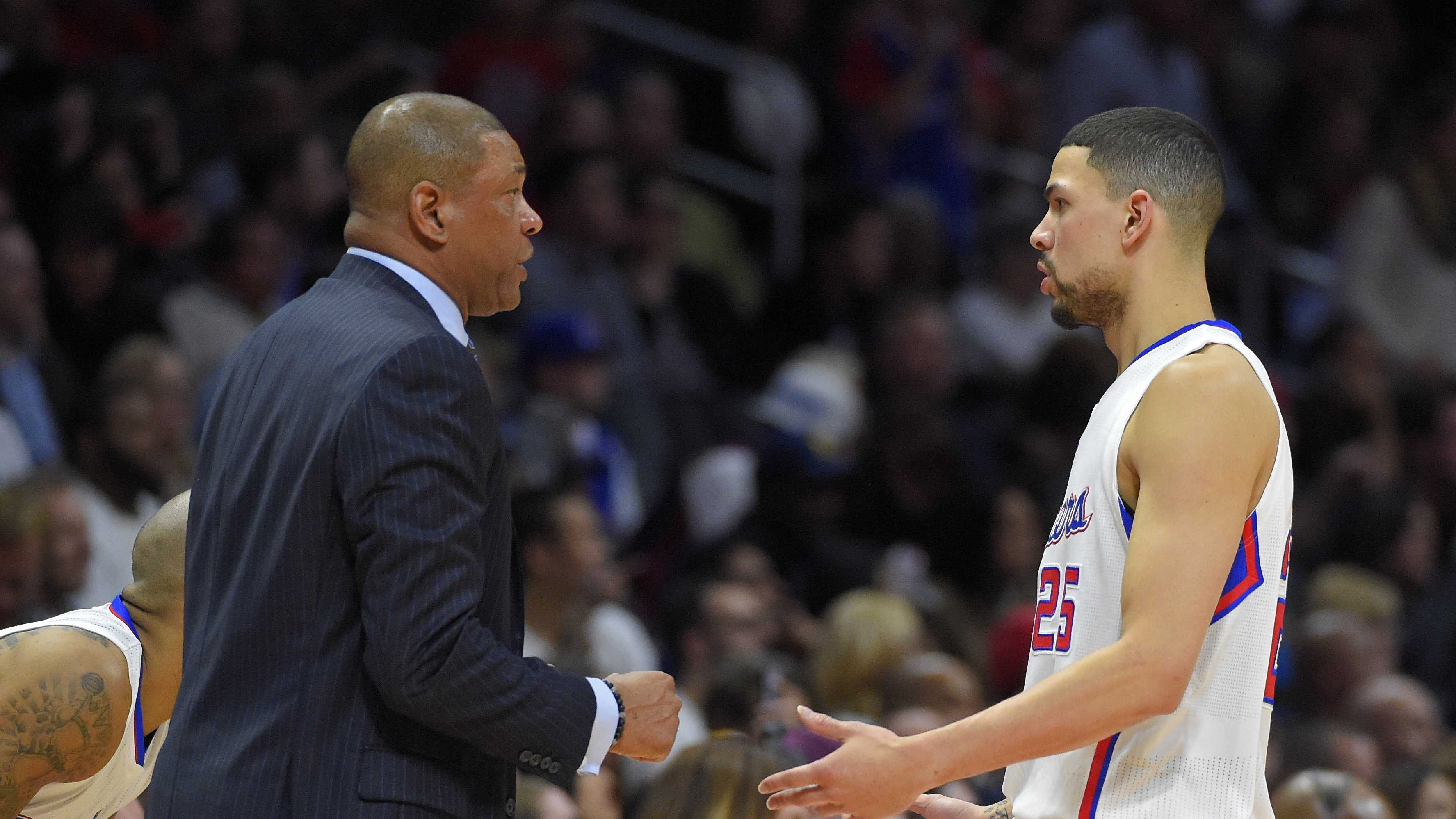 Los Angeles Clippers guard Austin Rivers, right, talks with his father, Clippers coach Doc Rivers, as he comes out of the NBA basketball game during the first half against the Cleveland Cavaliers, Friday, Jan. 16, 2015, in Los Angeles.