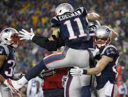 New England Patriots wide receiver Julian Edelman (11) celebrates with Rob Gronkowski, rear, after Gronkowski's five-yard touchdown pass catch during the second half of the NFL football AFC Championship game against the Indianapolis Colts Sunday, Jan. 18, 2015, in Foxborough, Mass.
