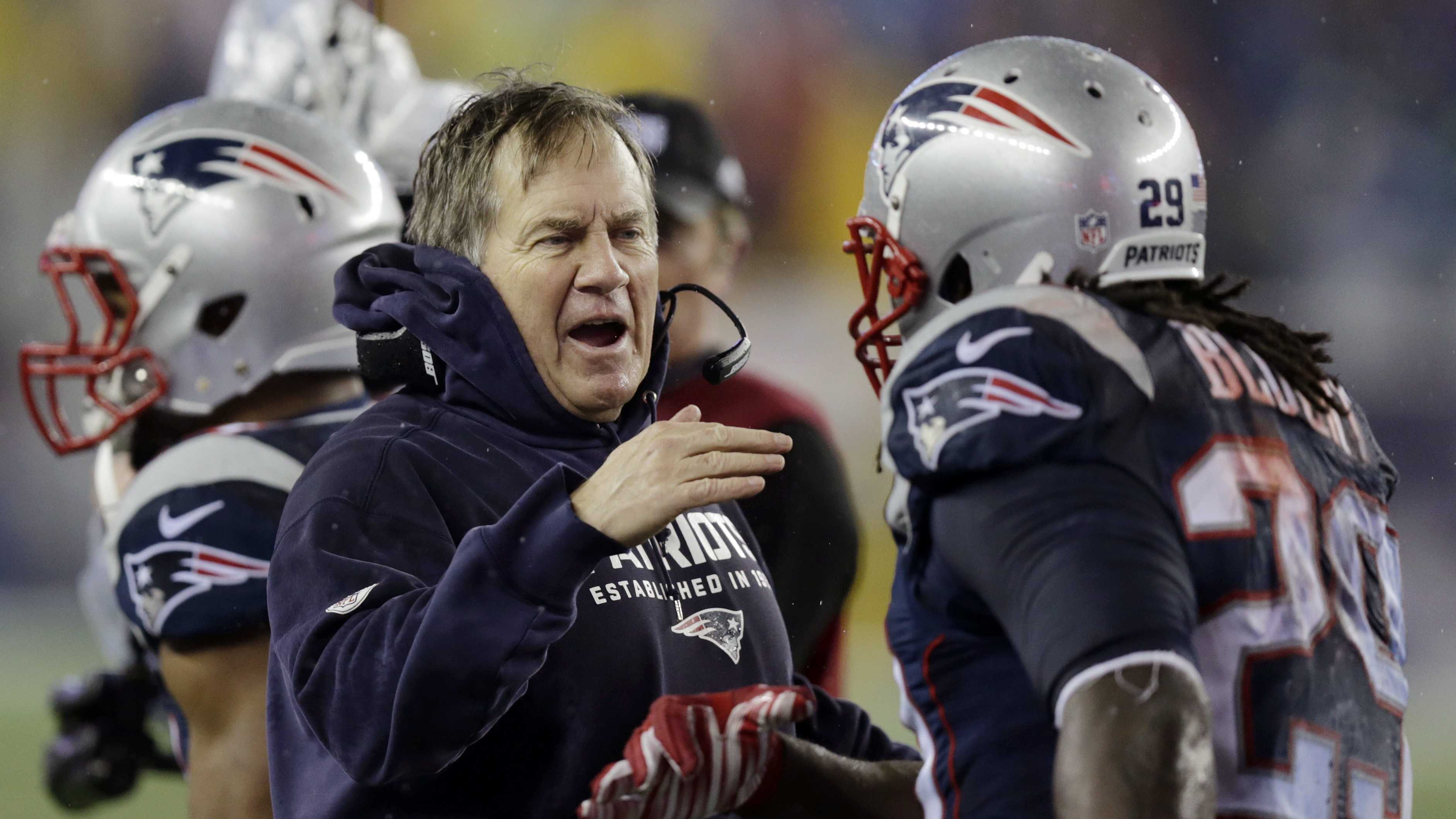 New England Patriots head coach Bill Belichick congratulates LeGarrette Blount after his touchdown during the second half of the NFL football AFC Championship game against the Indianapolis Colts Sunday, Jan. 18, 2015, in Foxborough, Mass.
