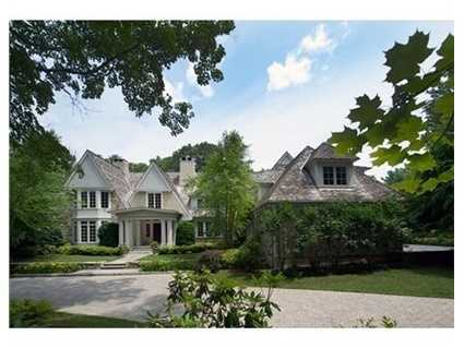 Exquisite Stone & Stucco estate set on 2 manicured acres in the Country Club neighborhood.
