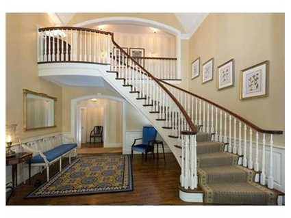 A two-story foyer with curved staircase.