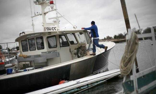 Marshfield lobsterman Ken Roth secures his boat Golden Girl on Monday, Jan. 26, 2015, in Green Harbor in preparation for the blizzard expected to hit Monday night.