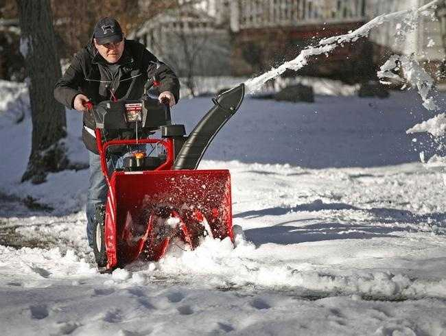 Dave Alleva of Quincy tries out a snowblower Sunday, Jan. 25, 2015, that his son Matt gave him for his birthday. It was the first time Dave was able to use the machine, but if forecasters are right, he'll be very busy using it this week.