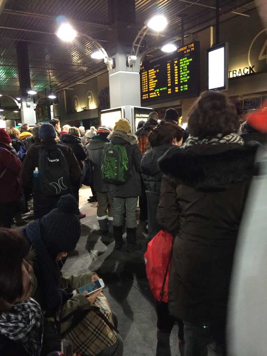 Frustrated commuters wait for a delayed train at North Station Monday night.