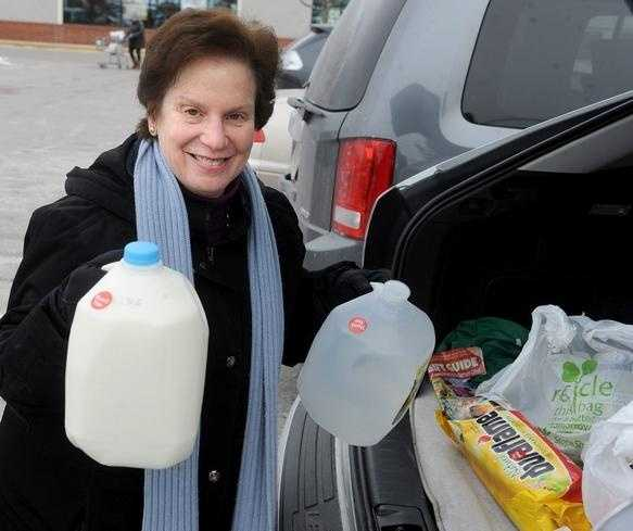 Judy Rhein of Framingham went supermarket shopping before the storm Monday.
