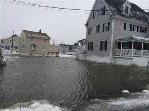 Water surrounds homes on aptly named Canal Street in Marshfield.