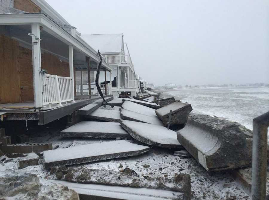 Destroyed sea wall on Bay Street in Marshfield. 2 homes damaged