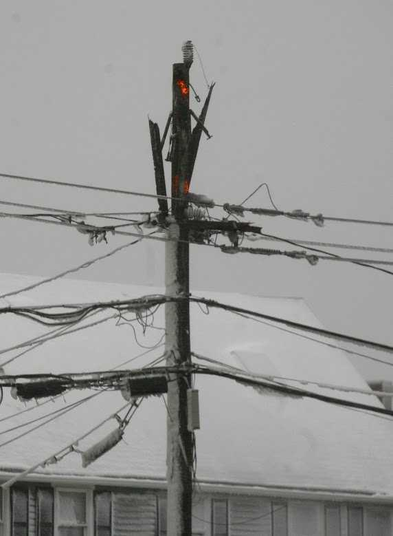 A damaged utility pole in Marshfield on Tuesday, January 27, 2015.