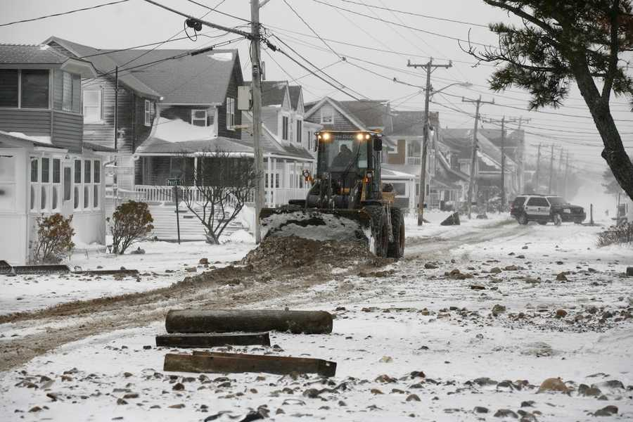 Dirt, snow, sand and debris are removed from roads in Marshfield on Tuesday, January 27, 2015.