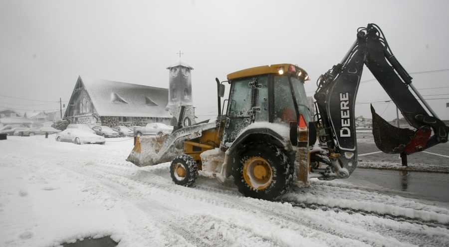 Heavy equipment is used to help clear snow after the blizzard in Marshfield on Tuesday, January 27, 2015.