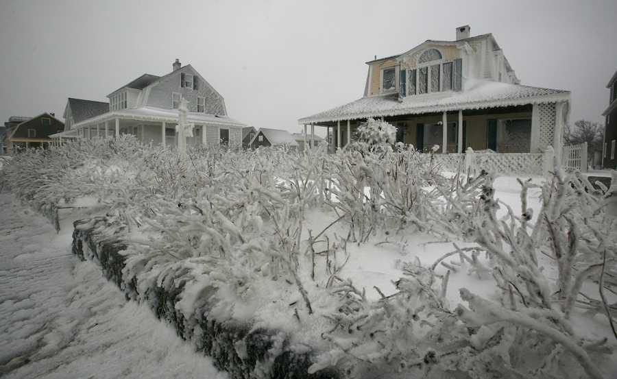 Homes along the coast in Marshfield are coated in ice during the blizzard on Tuesday, January 27, 2015.