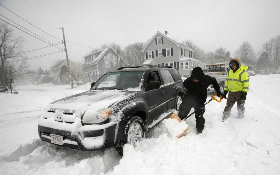 Help arrives after a driver gets stuck in Marshfield on Tuesday, January 27, 2015.