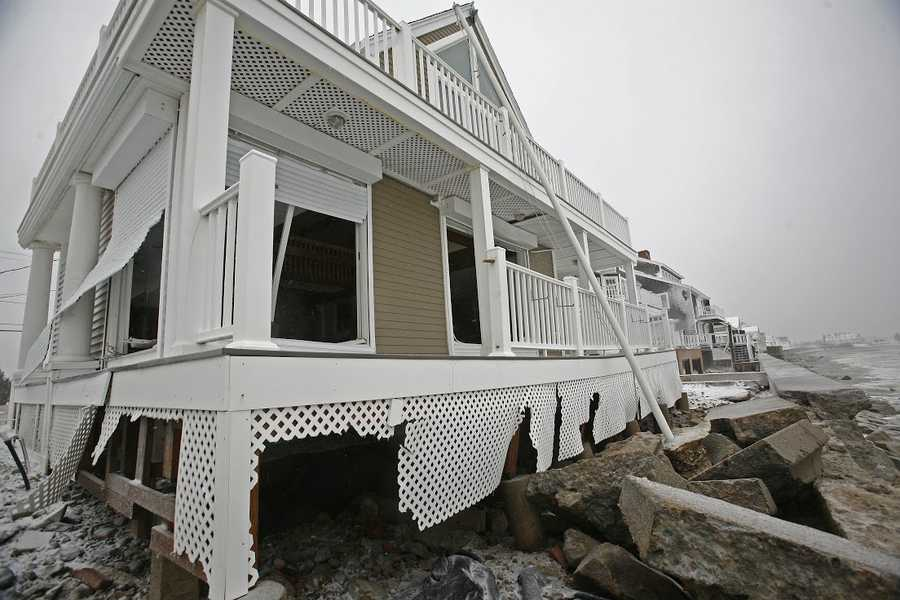 Several homes were damaged after a seawall collapsed on Tuesday, January 27, 2015.