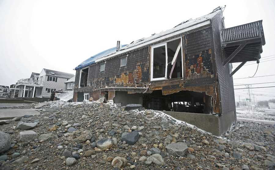 A home suffers severe damage during the blizzard in Marshfield on Tuesday, January 27, 2015.