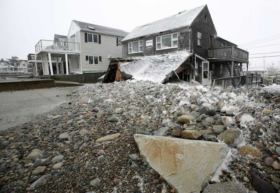 A Marshfield home is damaged during the blizzard on Tuesday, January 27, 2015.