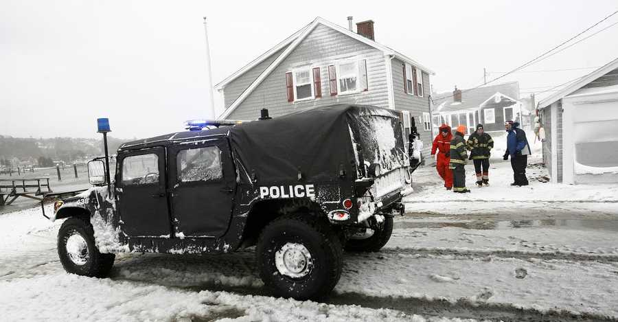 Officials assess the situation during the blizzard in Scituate on Tuesday, January 27, 2015.