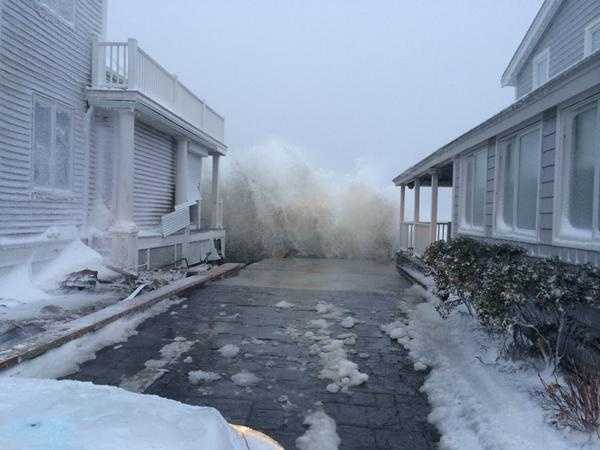 Powerful surf slams into oceanfront homes in Marshfield's Green Harbor Tuesday.