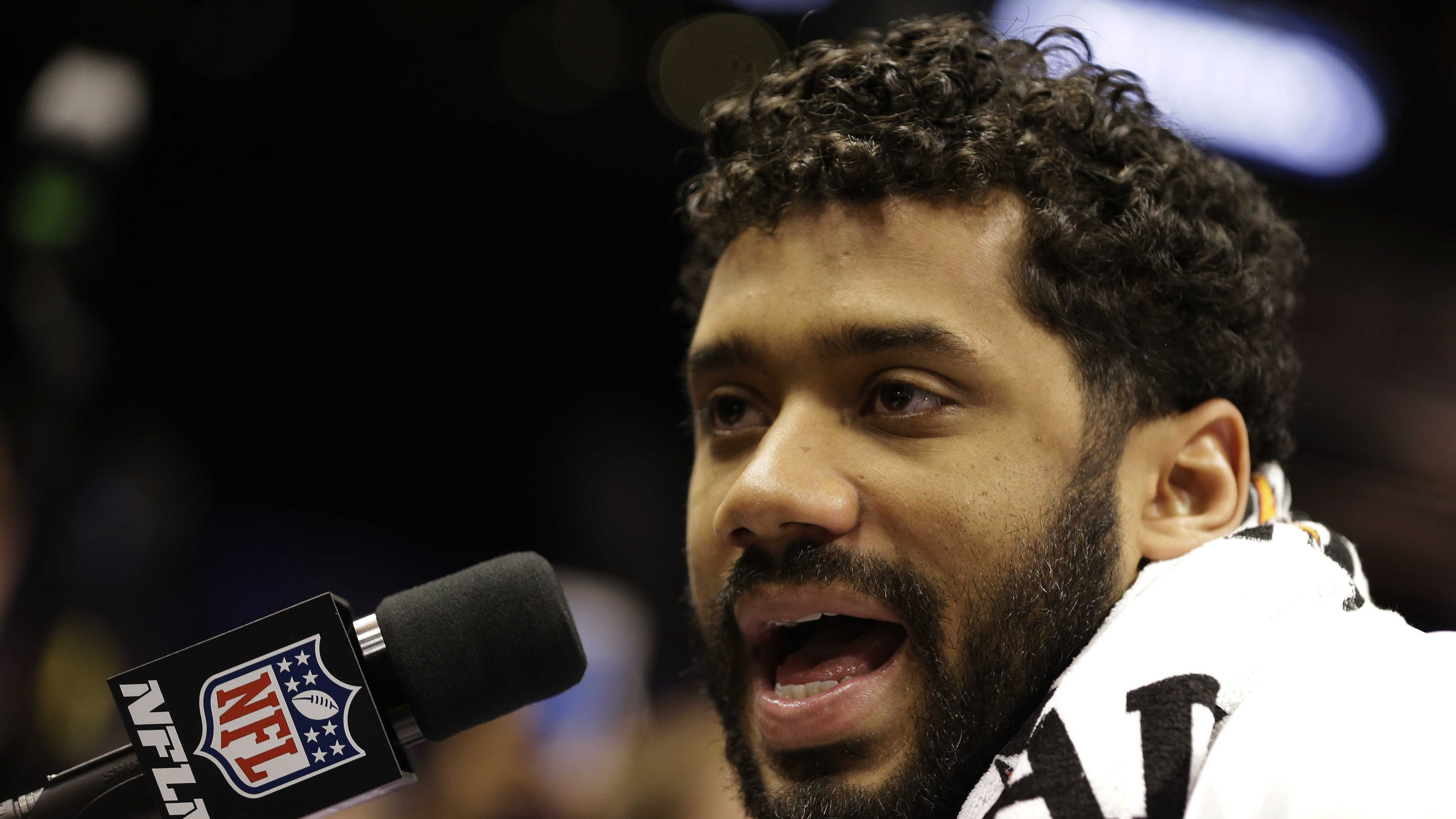Seattle Seahawks' Russell Wilson answers questions during media day for NFL Super Bowl XLIX football game Tuesday, Jan. 27, 2015, in Phoenix.