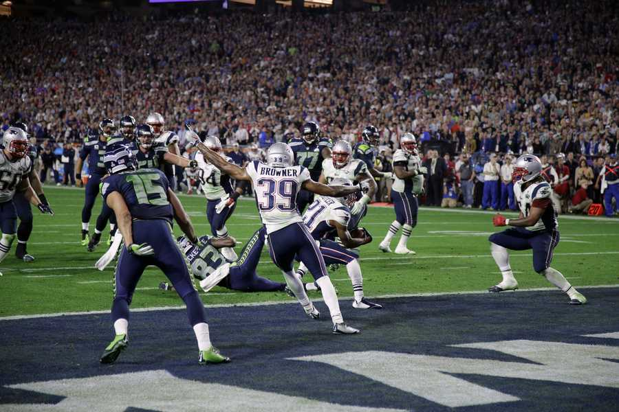 New England Patriots strong safety Malcolm Butler (21), center, intercepts a pass in the end zone during the second half of NFL Super Bowl XLIX football game