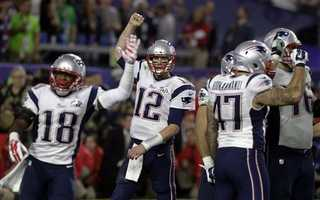New England Patriots quarterback Tom Brady (12)d celebrates with his teammates after NFL Super Bowl XLIX football game against the Seattle Seahawks.