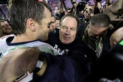 New England Patriots quarterback Tom Brady (12) and head coach Bill Belichick embrace.