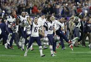 New England Patriots punter Ryan Allen (6), Danny Aiken (48) and teammates celebrate after the Patriots beat the Seattle Seahawks in the NFL Super Bowl XLIX football game Sunday, Feb. 1, 2015, in Glendale, Ariz.