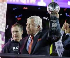 New England Patriots owner Robert Kraft holds up the Vince Lombardi Trophy after the NFL Super Bowl XLIX football game against the Seattle Seahawks Sunday, Feb. 1, 2015, in Glendale, Ariz. The Patriots won 28-24.
