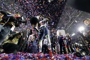 New England Patriots wide receiver Brandon LaFell (19) lifts his daughter after the Patriots beat the Seattle Seahawks to win the NFL Super Bowl XLIX football game Sunday, Feb. 1, 2015, in Glendale, Ariz.