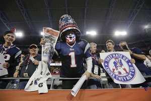 A New England Patriots fan celebrates