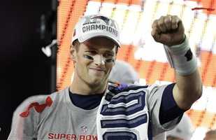 New England Patriots quarterback Tom Brady (12) celebrates after the NFL Super Bowl XLIX football game against the Seattle Seahawks Sunday, Feb. 1, 2015, in Glendale, Ariz. The Patriots won the game 28-24.