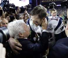 New England Patriots quarterback Tom Brady (12) celebrates with owner Robert Kraft after the NFL Super Bowl XLIX football game against the Seattle Seahawks Sunday, Feb. 1, 2015, in Glendale, Ariz. The Patriots won 28-24.