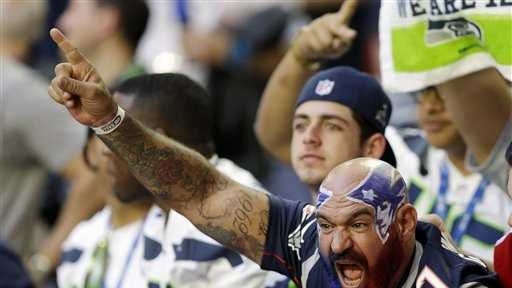 Fans cheer during warm ups before the NFL Super Bowl XLIX football game between the Seattle Seahawks and the New England Patriots on Sunday, Feb. 1, 2015, in Glendale, Ariz.