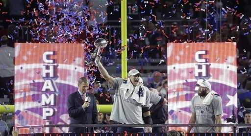 New England Patriots tight end Rob Gronkowski raises the Vince Lombardi Trophy after the Patriots beat the Seattle Seahawks in the NFL Super Bowl XLIX football game Sunday, Feb. 1, 2015, in Glendale, Ariz.
