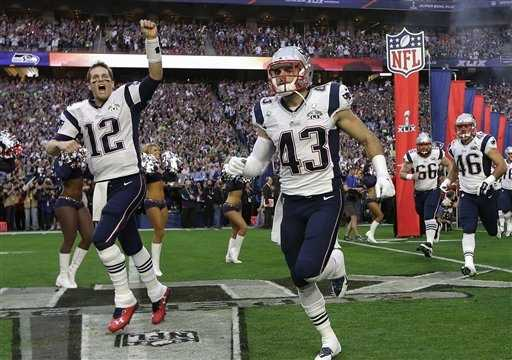 New England Patriots quarterback Tom Brady (12) and defensive back Nate Ebner (43) run  onto the field before the NFL Super Bowl XLIX football game against the Seattle Seahawks Sunday, Feb. 1, 2015, in Glendale, Ariz.