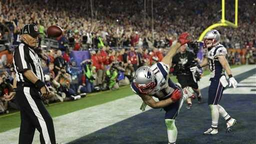 New England Patriots wide receiver Julian Edelman (11) spikes the ball after catching a three-yard touchdown pass during the second half of NFL Super Bowl XLIX football game against the Seattle Seahawks Sunday, Feb. 1, 2015, in Glendale, Ariz.