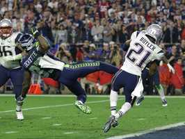 New England Patriots strong safety Malcolm Butler (21) intercepts a pass in front of Seattle Seahawks wide receiver Ricardo Lockette (83) in Super Bowl XLIX  Sunday, Feb. 1, 2015, in Glendale, Ariz., clinching the Patriots fourth Super Bowl win.