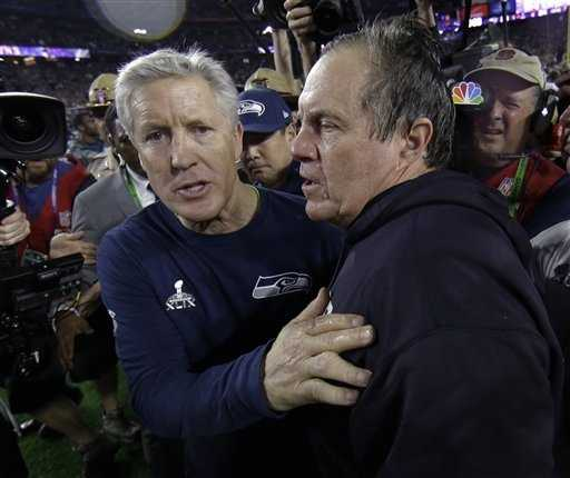 Seattle Seahawks head coach Pete Carroll, left, congratulates New England Patriots head coach Bill Belichick after NFL Super Bowl XLIX football game Sunday, Feb. 1, 2015, in Glendale, Ariz. The Patriots won 28-24.