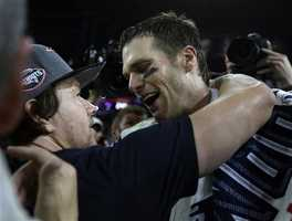 New England Patriots quarterback Tom Brady (12) celebrates with actor Mark Wahlberg after the NFL Super Bowl XLIX football game against the Seattle Seahawks Sunday, Feb. 1, 2015, in Glendale, Ariz. The Patriots won 28-24.