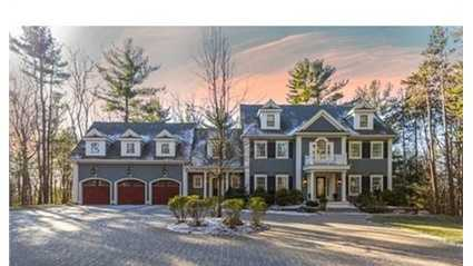 Long, sweeping driveway leads to pavered Courtyard in front of this gorgeous Estate