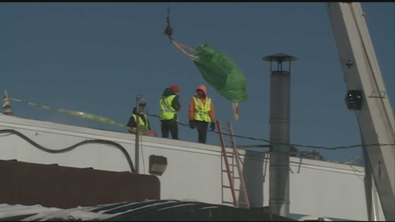 Workers in Londonderry spent the day Friday using cranes to clear snow off the roof of a school building ahead of the next big storm.